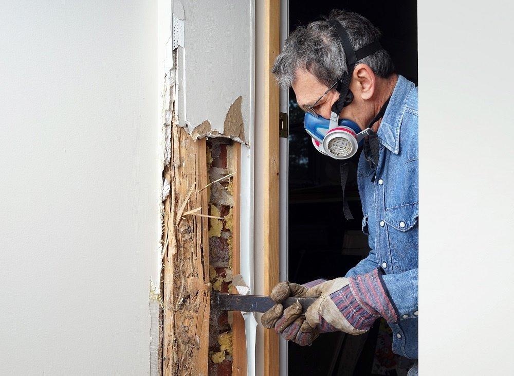 Man Scraping Wood