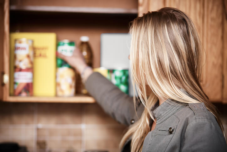Woman retrieving drygoods from a pantry with pests in Florida.