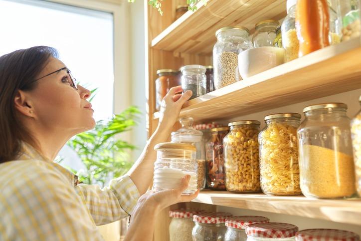 Woman Checking food in airtight jars